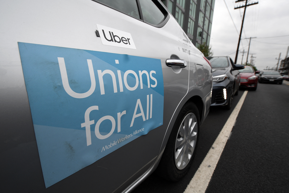 Uber car with Unions for all banner on the side